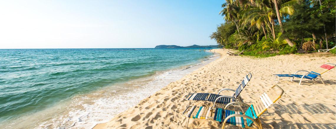 lounge chairs on sandy beach